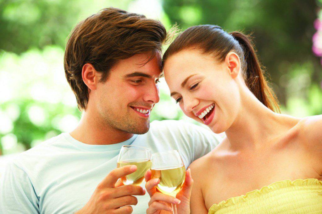 Couple drinking white wine