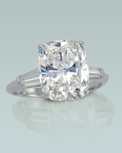 7c9fc820d Turgeon Raine Engagement Ring. Platinum ring with Cushion cut diamond and 2  tapered baguette cut diamonds.