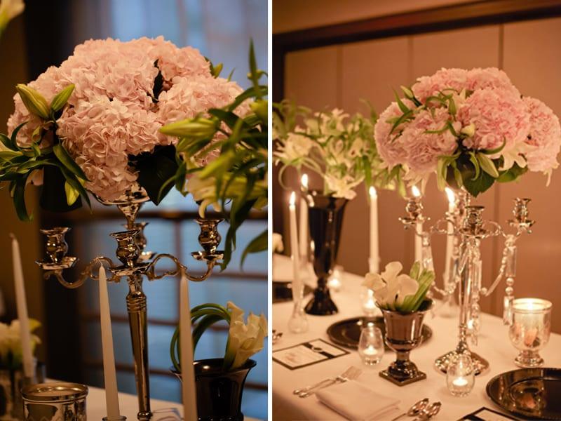 Pink flowers black candelabras