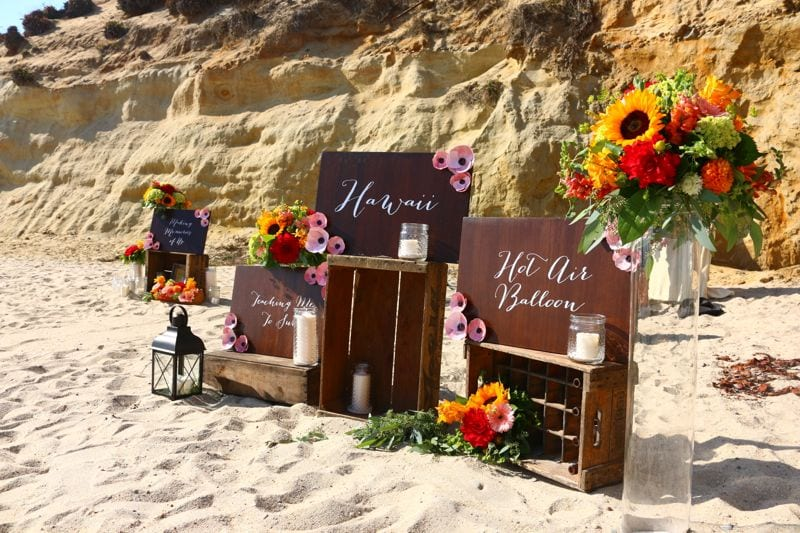 Wooden Calligraphy Signs On Crates The Beach