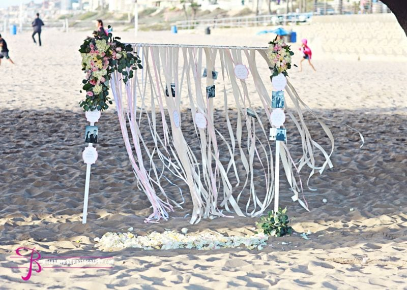 ribbon arch with flowers and love notes