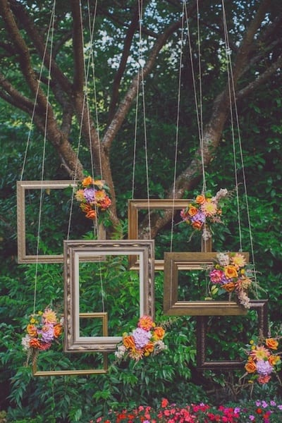 diy backdrop with frames and flowers