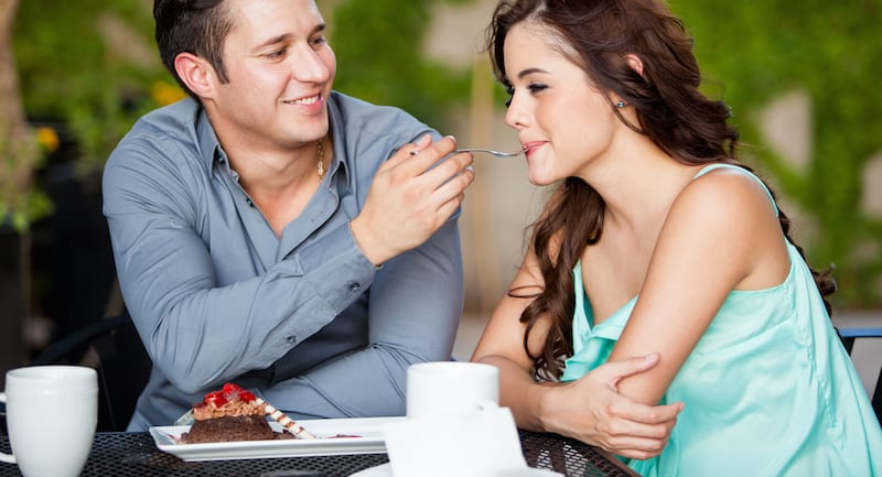 couple sharing dessert on date