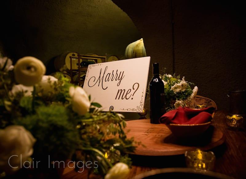 alice in wonderland marry me sign