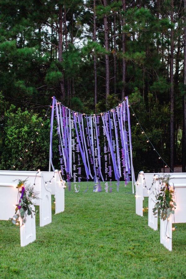 shades of purple ribbon wedding alter backdrop