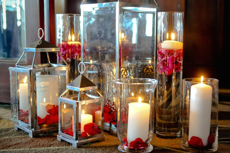silver lanterns white candles red flowers marriage proposal