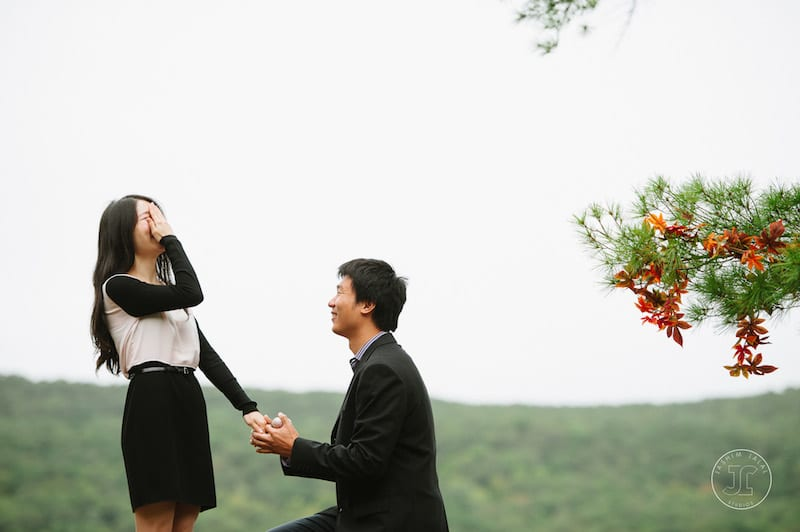 down on one knee surprise proposal