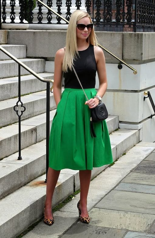 girl in black and green for a wedding