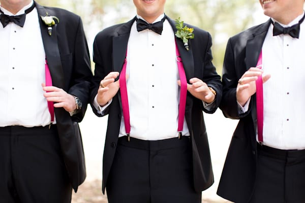 pink suspenders under grooms coat