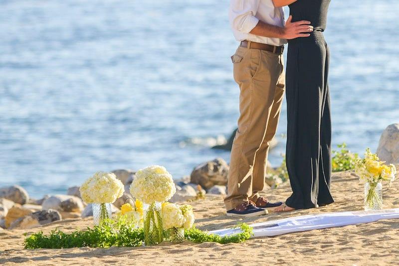 beautiful couple walking along beach