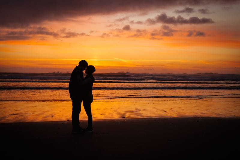 sunset beach couple silhouette