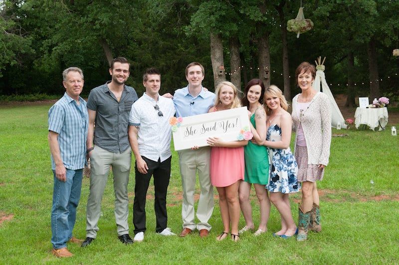 family and parents at marriage proposal she said yes