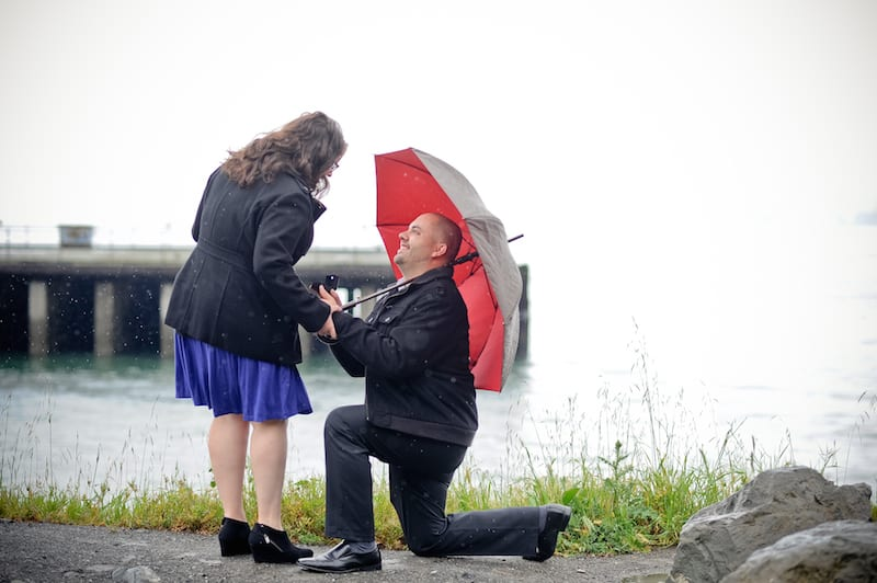 man down on one knee in the rain