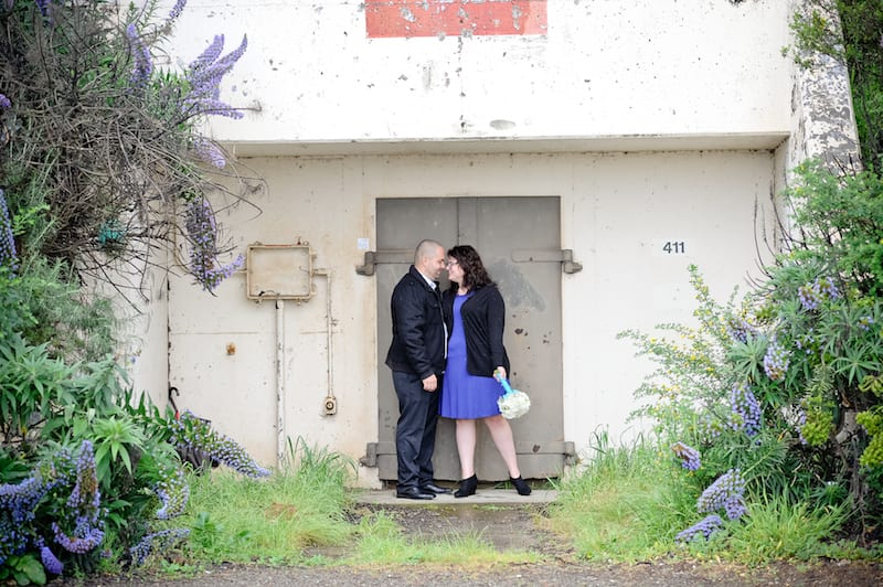 man and woman kissing in doorway