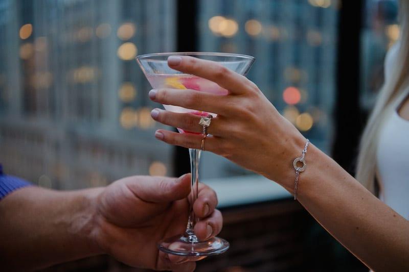 engaged gal drinking raspberry lemon drop martini