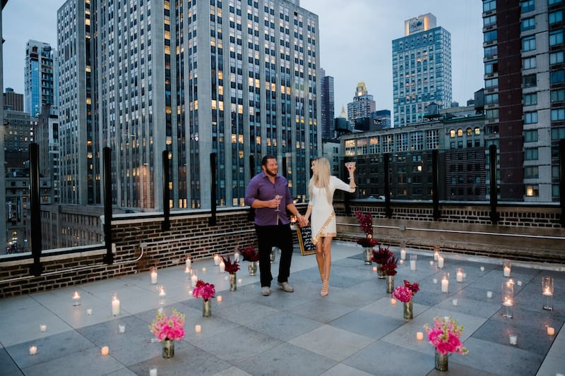 Rooftop Proposal in NYC with view of Empire State Building