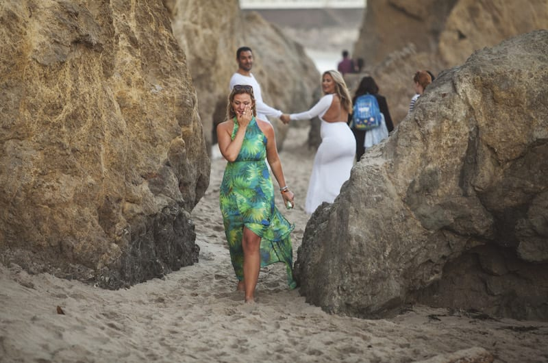 girl walking on beach crying