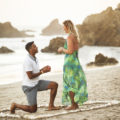 beach proposal with heart in sand