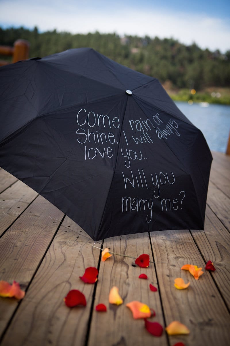 """will you marry me"" in fall at lake"