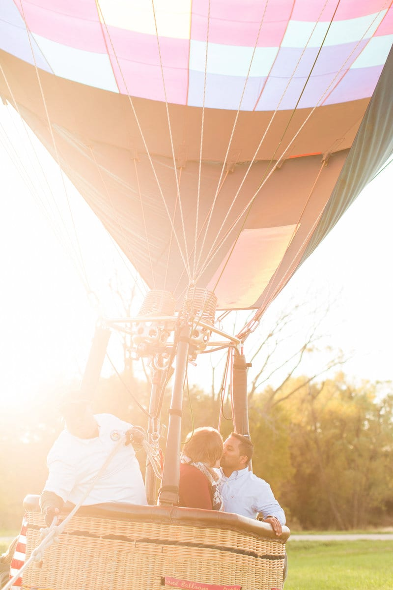 couple in hot air balloon kissing