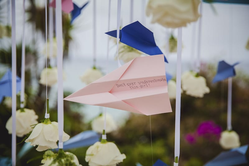 wedding proposal with pink paper plane
