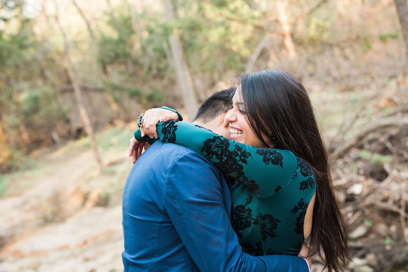 engaged man and woman hugging