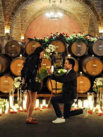 red roses candles wine barrels proposal