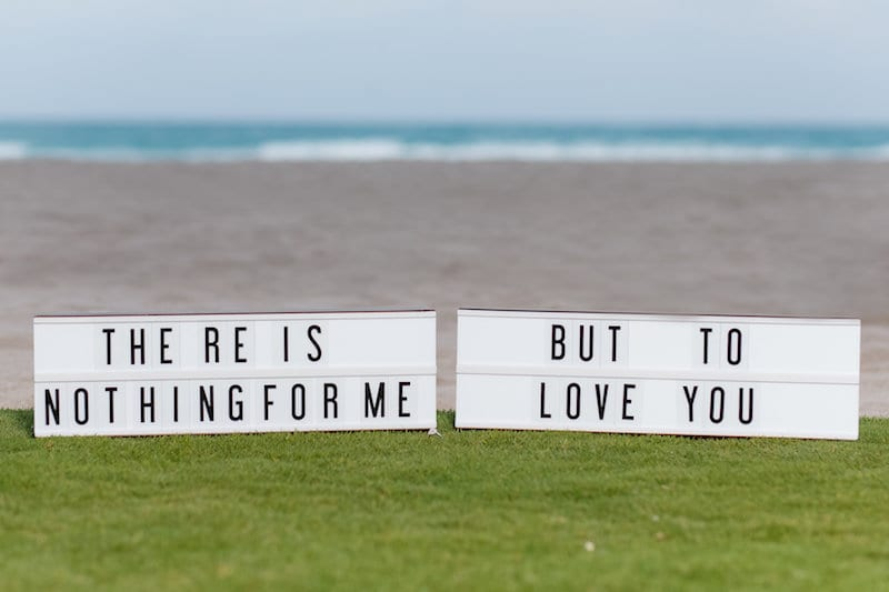 lyrics on lightbox on beach