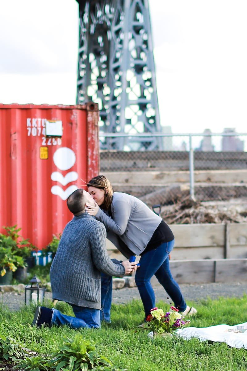 couple getting engaged at picnic in ny
