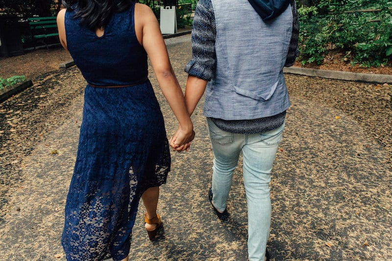 couple holding hands in Portland