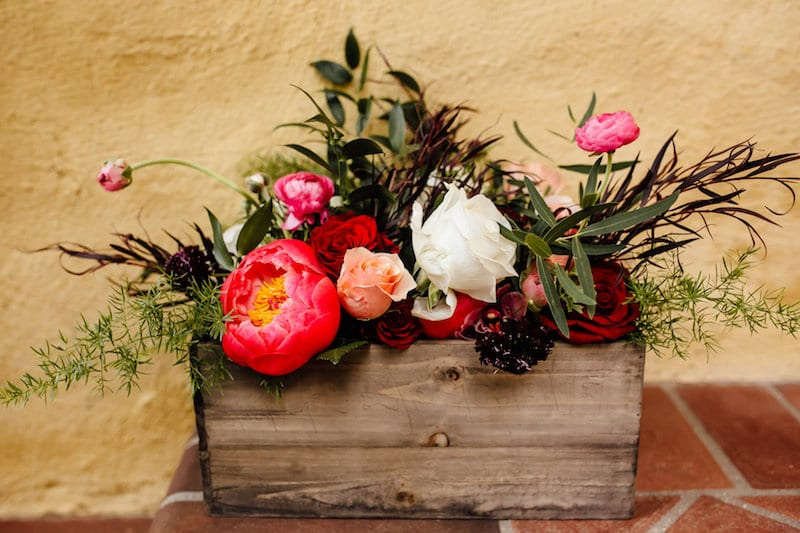 pink peony arrangement in wooden box