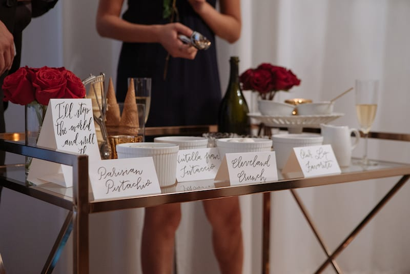 gold drink cart with calligraphy name tents