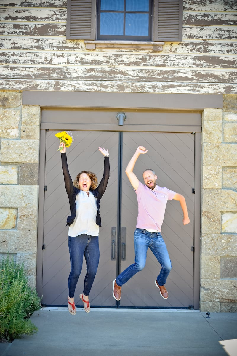 couple jumping for joy after proposal