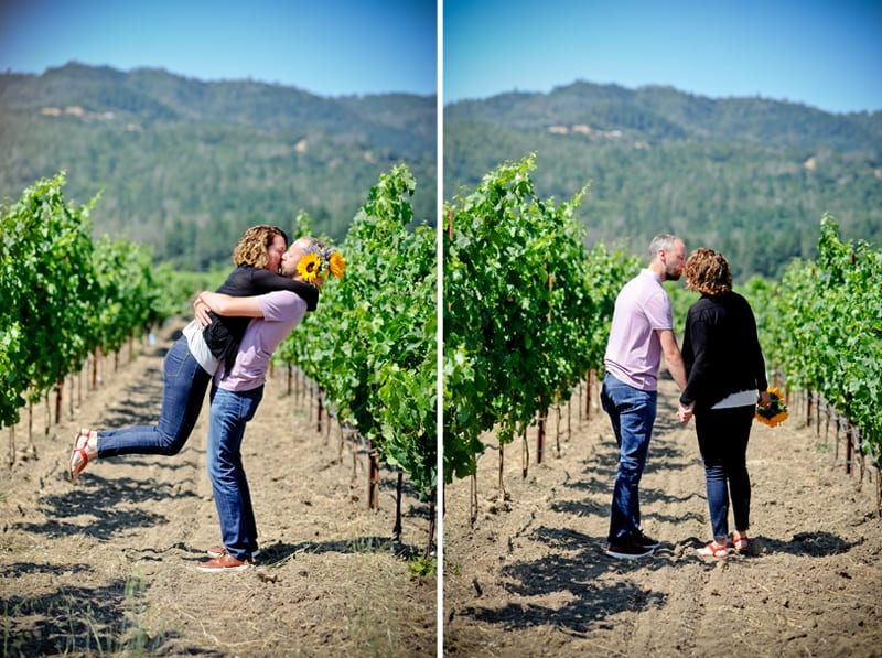 couple kissing in a vineyard