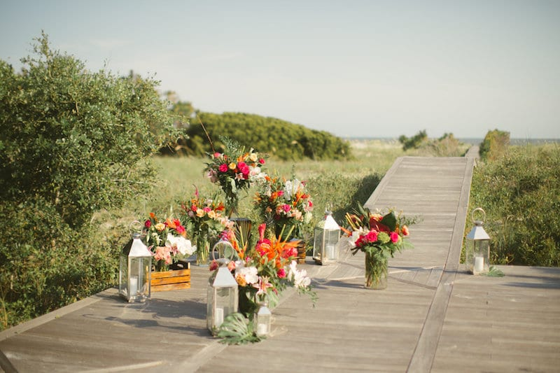 tropical floral arrangements on boardwalk