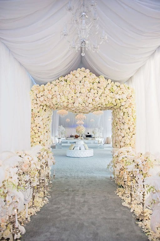 archway into reception white flowers