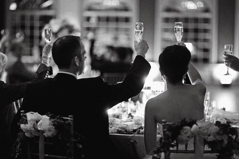 bride and groom toast at reception