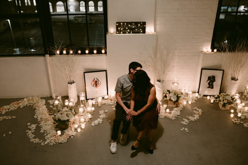 candles and white rose petals engagement