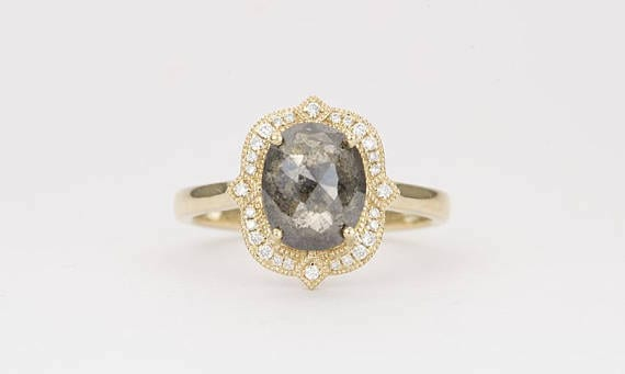 unique engagement ring with halo and yellow gold