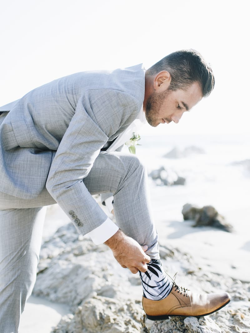 sock for groom on beach