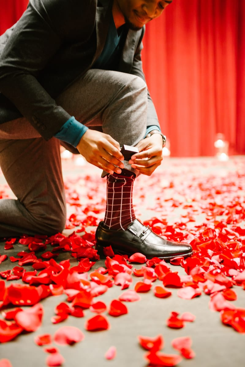 red roses and candles proposal