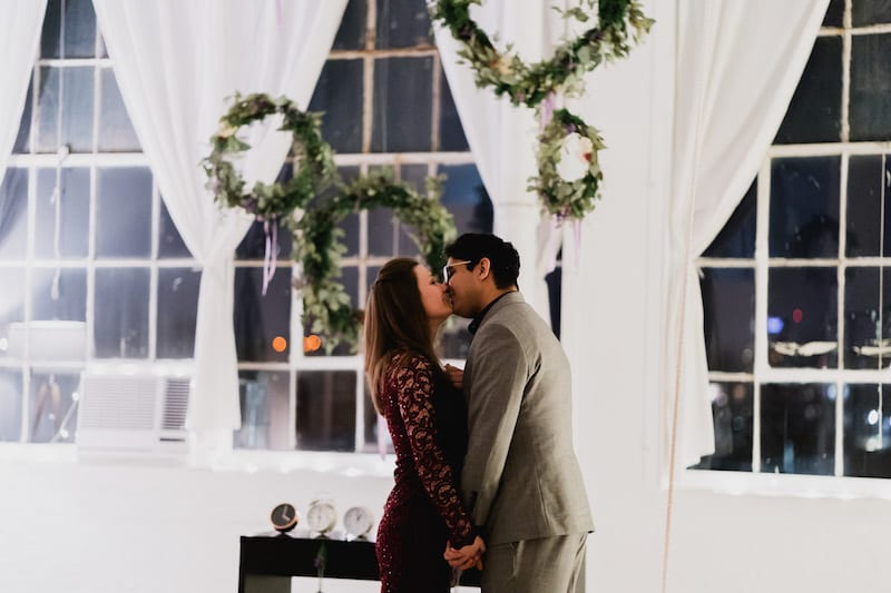 couple kissing after proposal