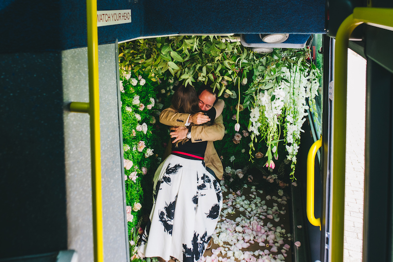 man down on one knee on bus