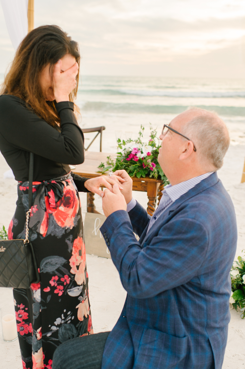man proposing on the beach in florida