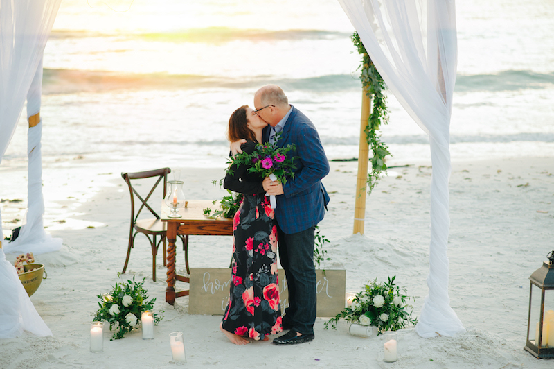 couple kissing after getting engaged on sarasota beach