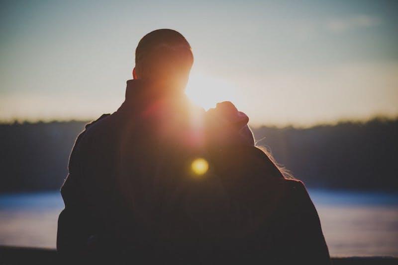 couple at sunset on lake