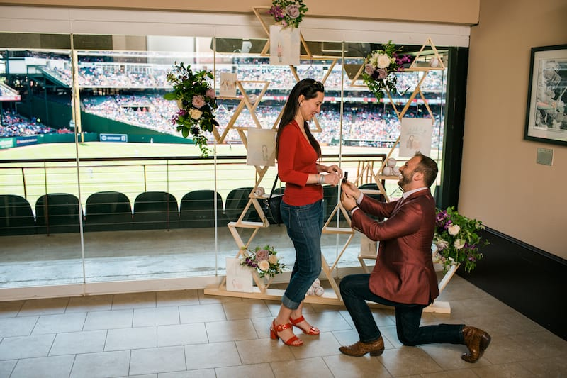 proposal at baseball stadium suite