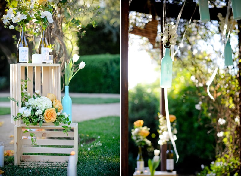 hanging wine bottles from trellis
