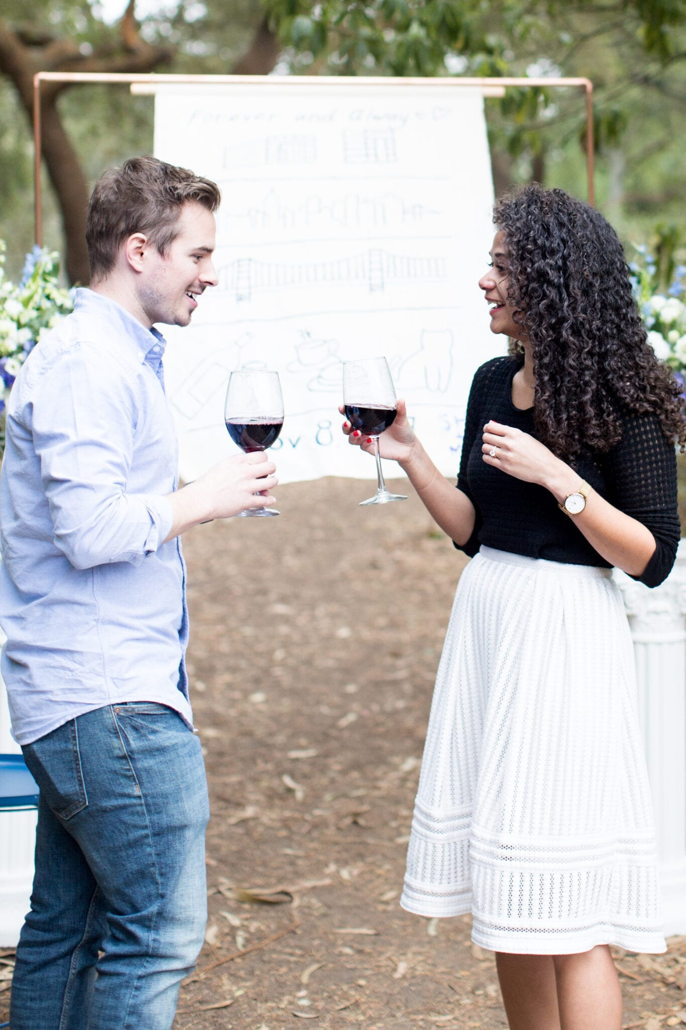 couple toasting after engagement