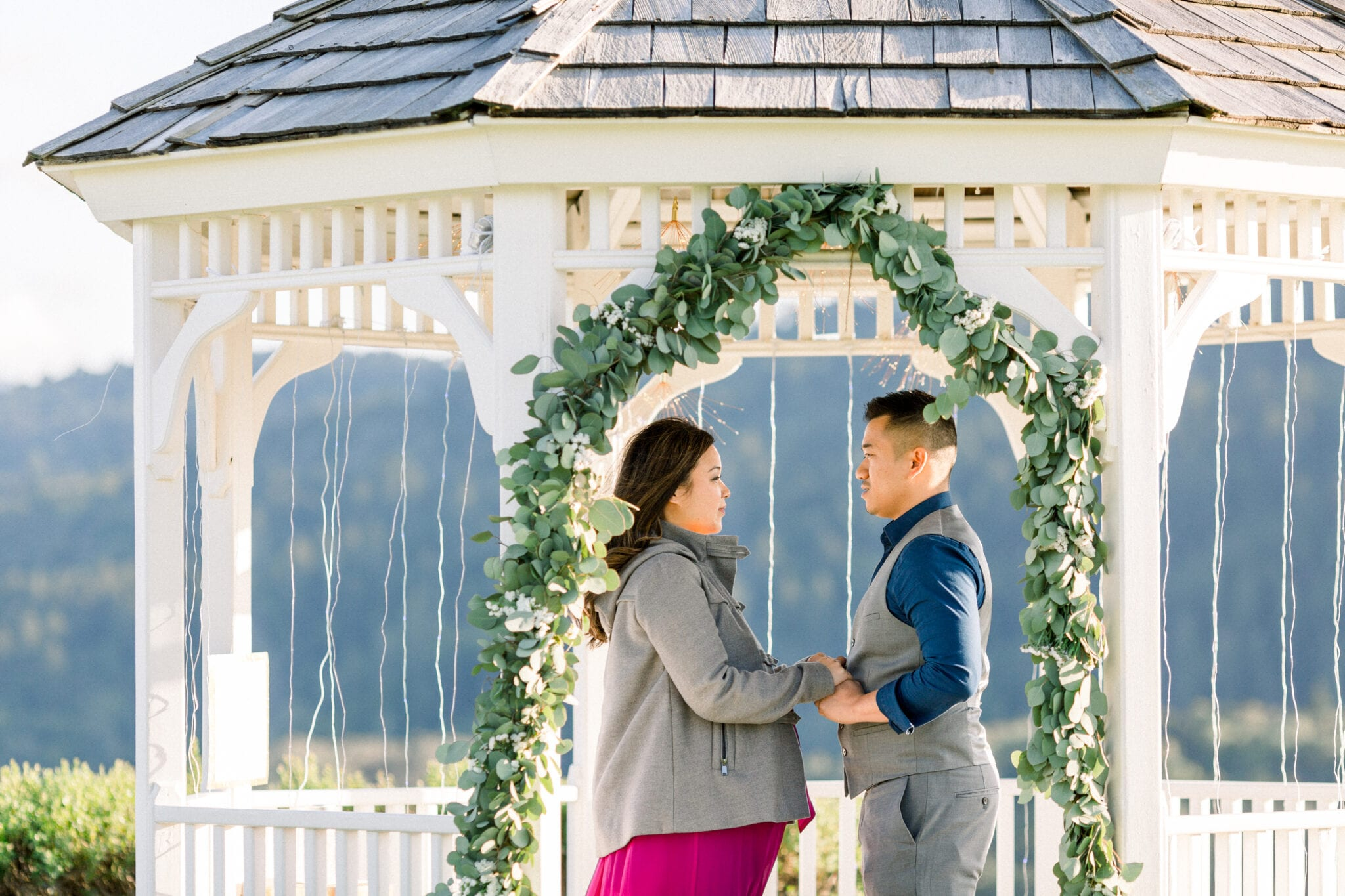 Couple holding hands in gazebo